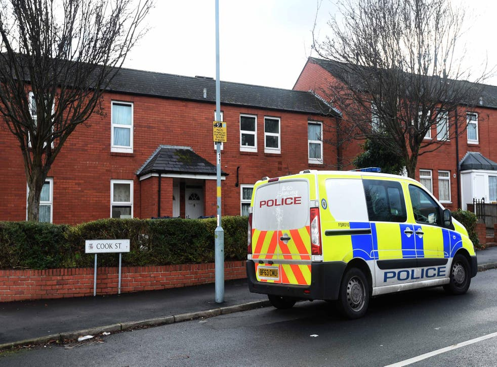 Two people have been arrested after a seven-year-old was found dead outside his home