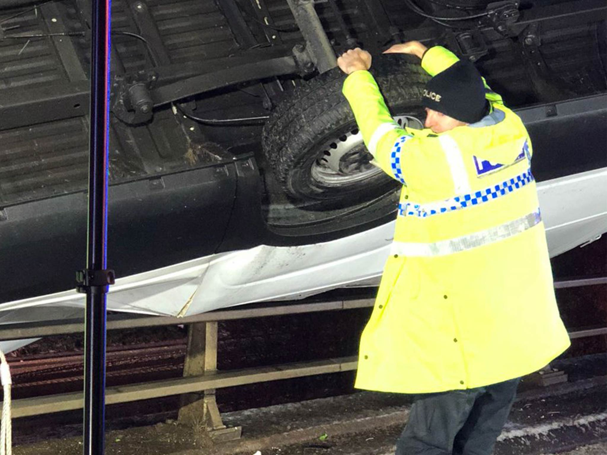 Police officer stops van falling off bridge