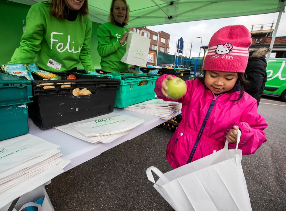 Children load up on fresh fruit and vegetables at Stanhope Primary school