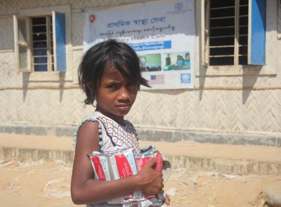 A Rohingya girl with supplies of therapeutic food at the Balukhali refugee camp