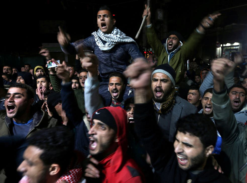Palestinians react during a protest against Donald Trump's decision to recognise Jerusalem as Israel's capital, in Khan Younis in the southern Gaza Strip