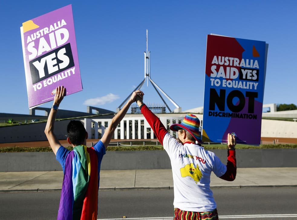 Campaigners in front of Australia's Parliament House in Canberra ahead of the vote on same-sex marriage