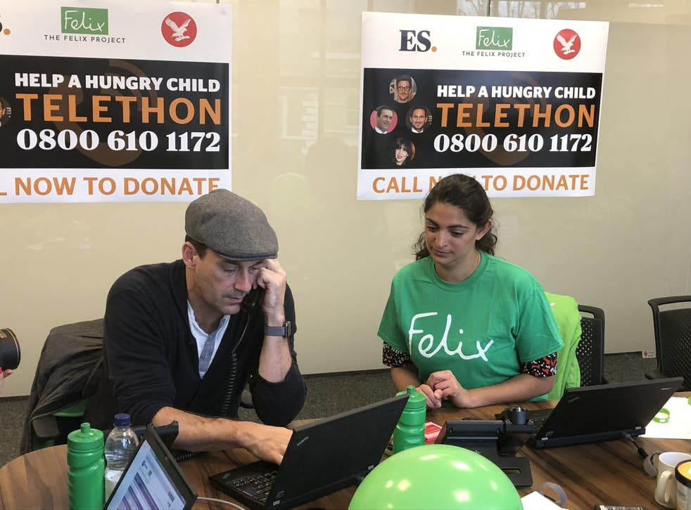 Jon Hamm answering calls in today's Christmas appeal telethon