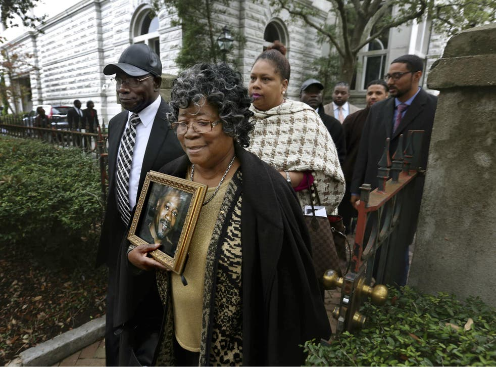 The parents of Walter Scott, Walter Scott Sr. and Judy Scott, leave the courthouse after former North Charleston police officer Michael Slager was sentenced to 20 years in prison for the 2015 shooting death of their son.