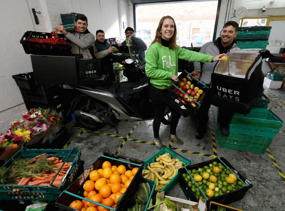 UberEATS drivers pick up food from the Felix depot to be taken to Berrymede Junior School in Acton