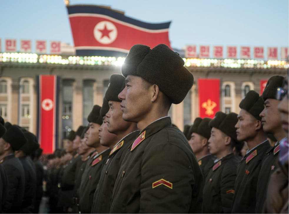 North Korean soldiers attend a mass rally