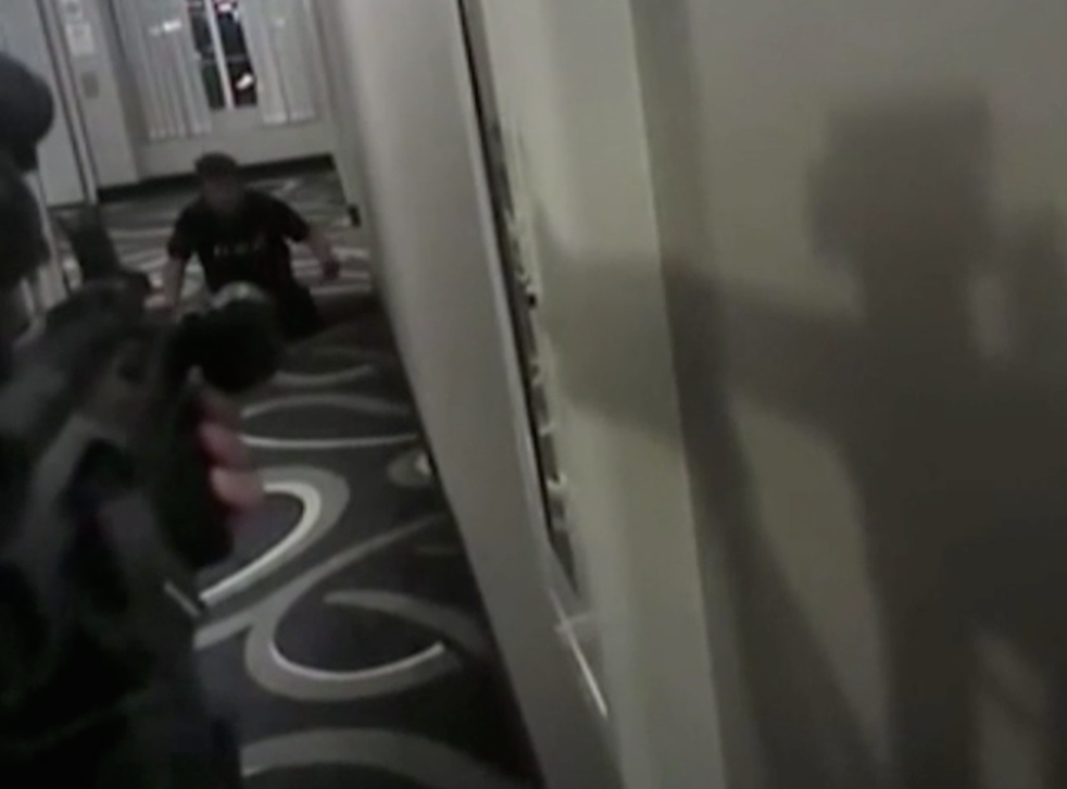 Daniel Shaver is seen putting his hands up before police shoot him