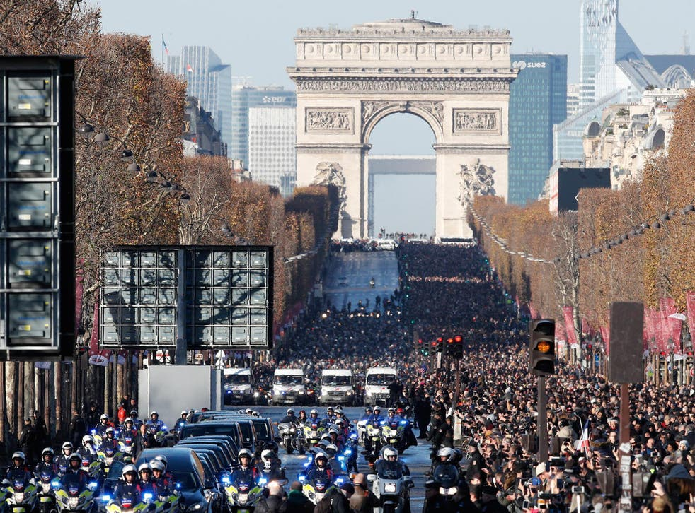 A motorcycle parade in the French capital follows the hearse carrying rock legend Hallyday