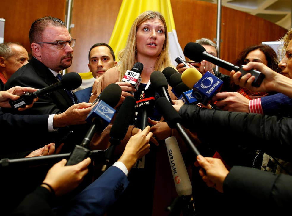Beatrice Fihn, Executive Director of the International Campaign to Abolish Nuclear Weapons (ICAN), who was awarded the 2017 Nobel Peace Prize, talks with reporters