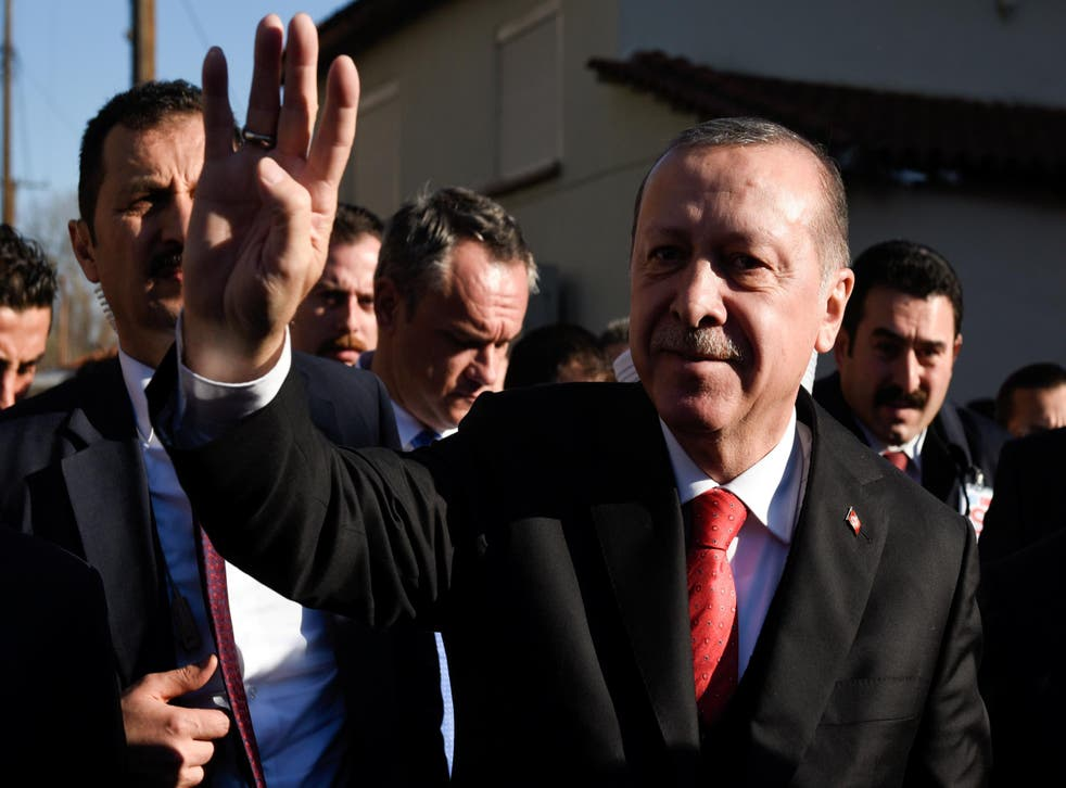 Turkish President Tayyip Erdogan waves as he exits a mosque following Friday prayers in the city of Komotini, Greece on 8 December 2017
