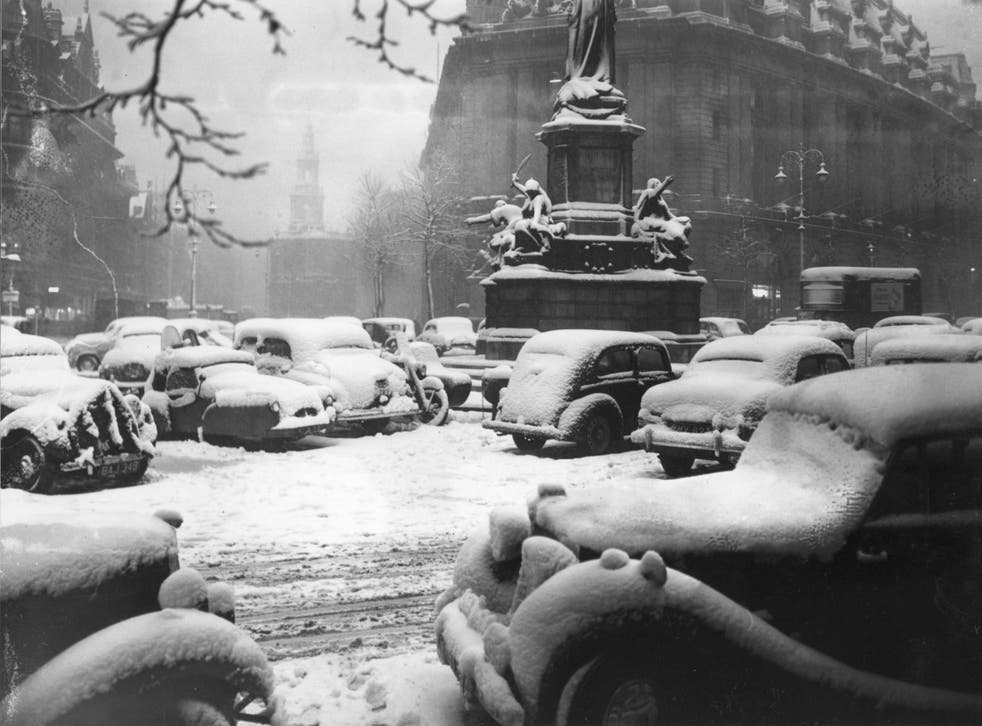 Picture: Snow-covered cars parked near Aldwych and the Strand, London