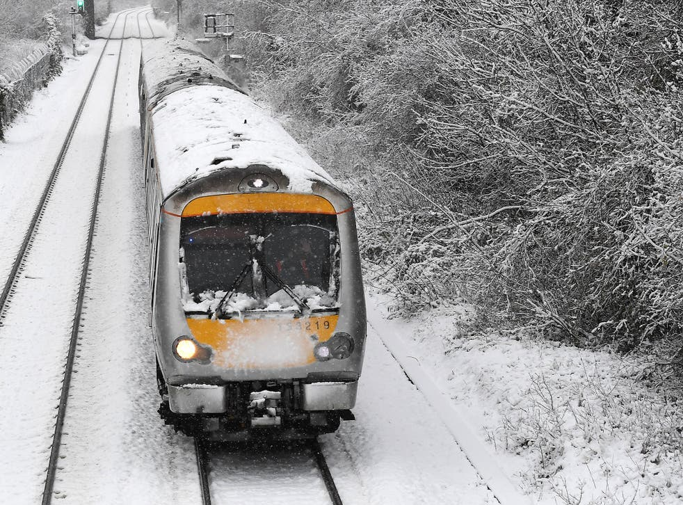 A train travels through snow at High Wycombe, west of London