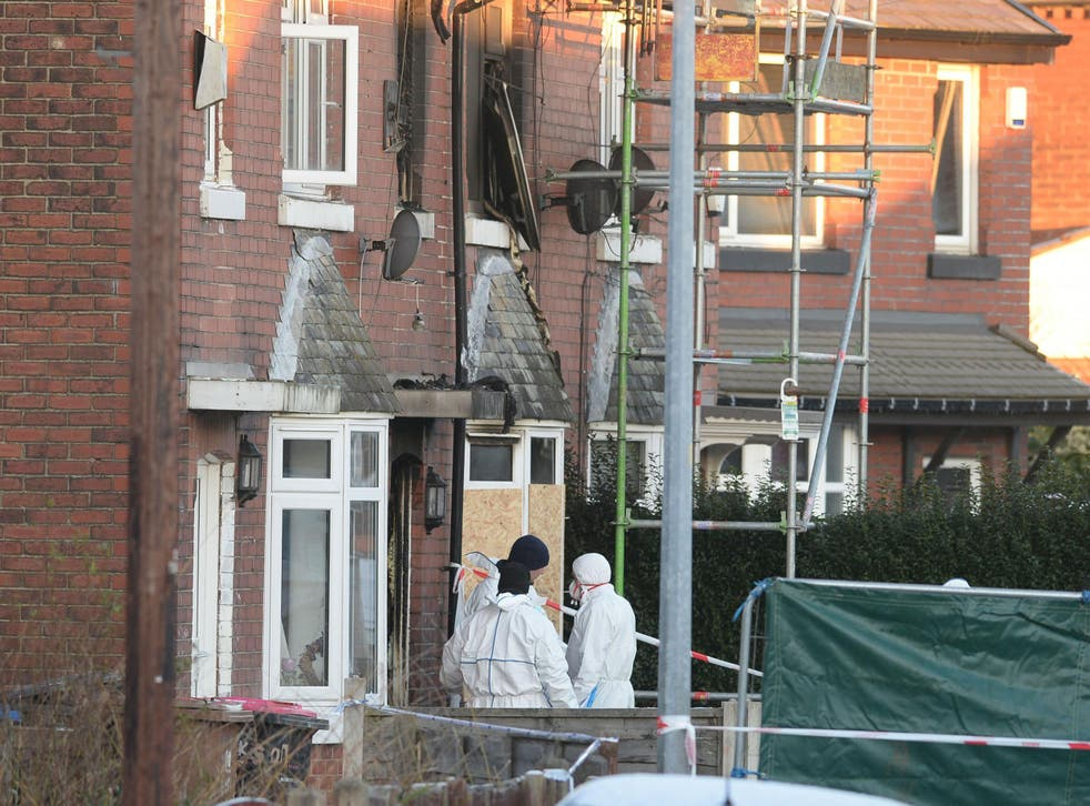 Forensic officers at the scene of a house fire on Jackson Street in Worsley, Greater Manchester, as a murder inquiry has been launched after three children died following the fire