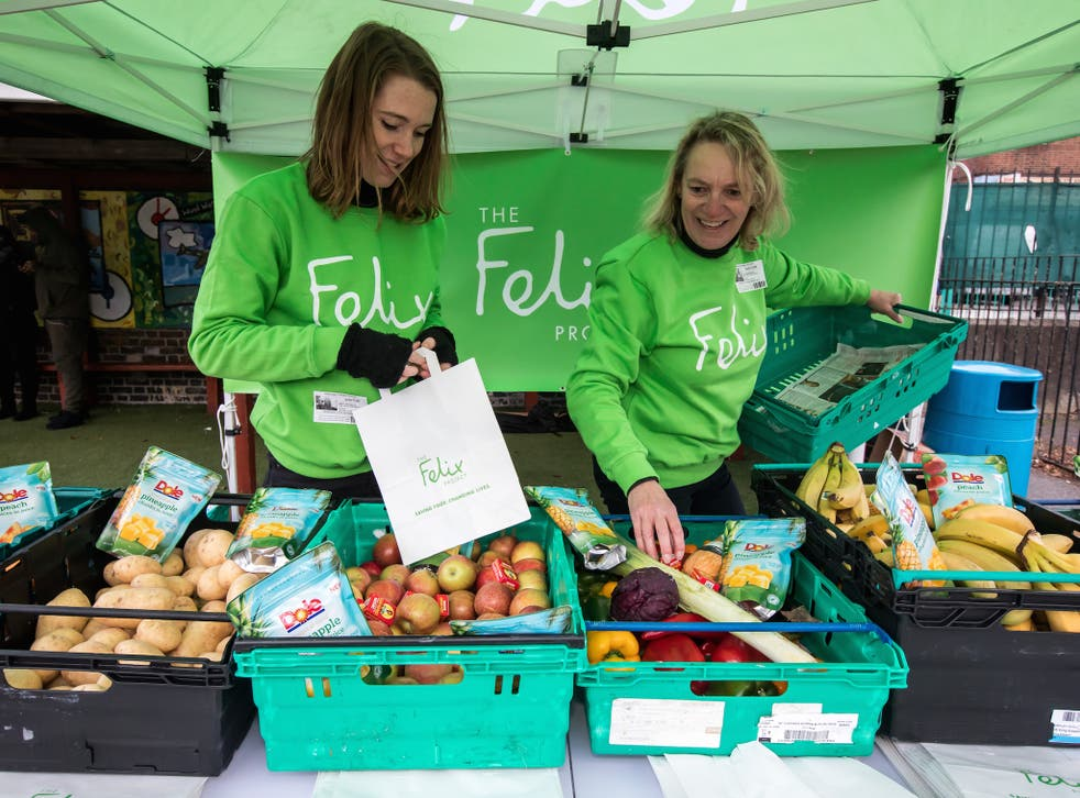 Felix volunteers load up bags of produce for children and their parents at Stanhope primary