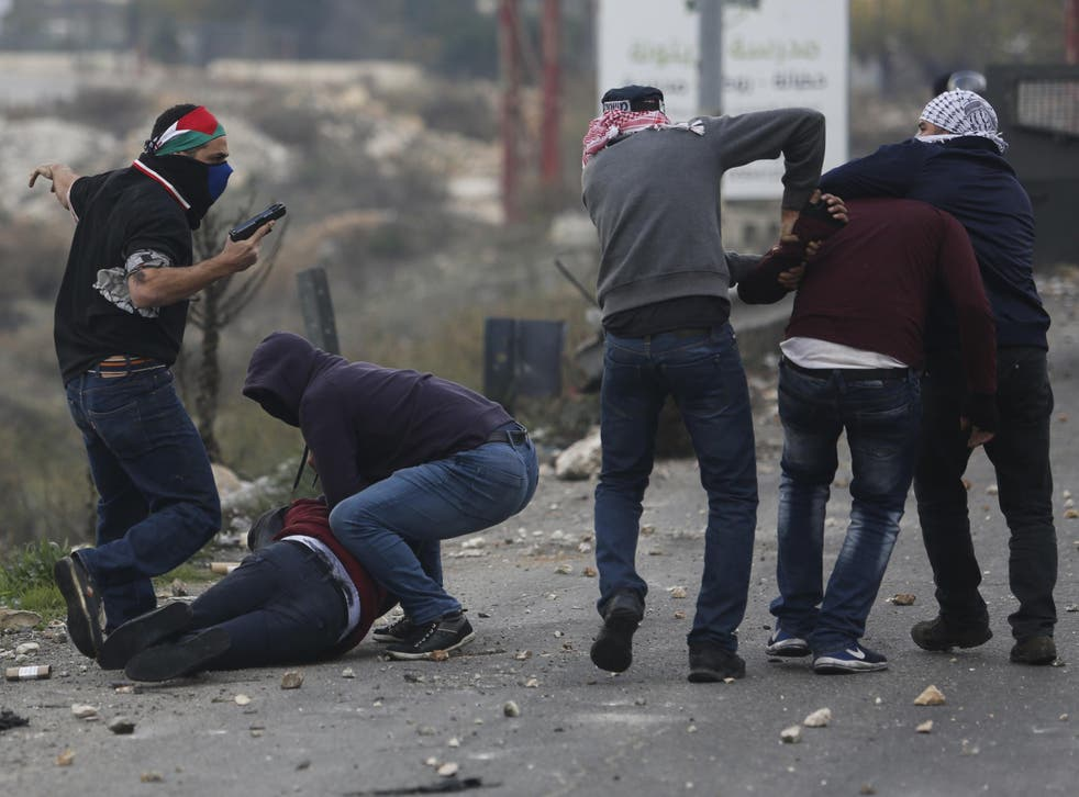 Undercover Israeli police arrest Palestinian demonstrators during clashes following protests against US President Donald Trump's decision to recognise Jerusalem as the capital of Israel, in the West Bank city of Ramallah