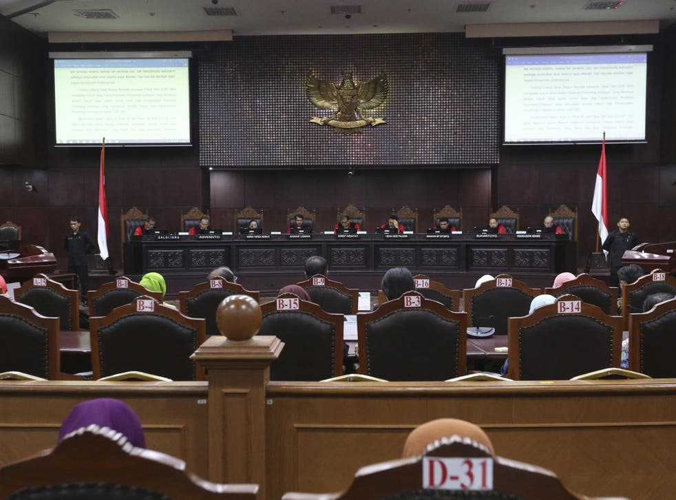 Judges read their verdict on the case of a petition seeking to make gay sex and sex outside marriage illegal during a hearing at the Constitutional Court in Jakarta