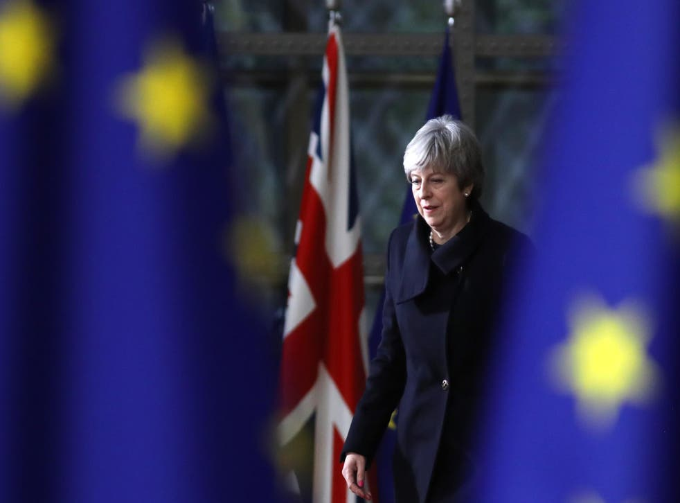 Theresa May arrives for the European Union leaders summit at the European Council in Brussels