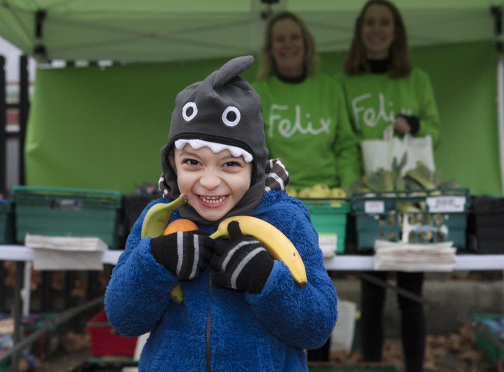 One of the first happy customers at the Felix Project's new market stall at Berrymede Junior School in west London - paid for with the help of your donations