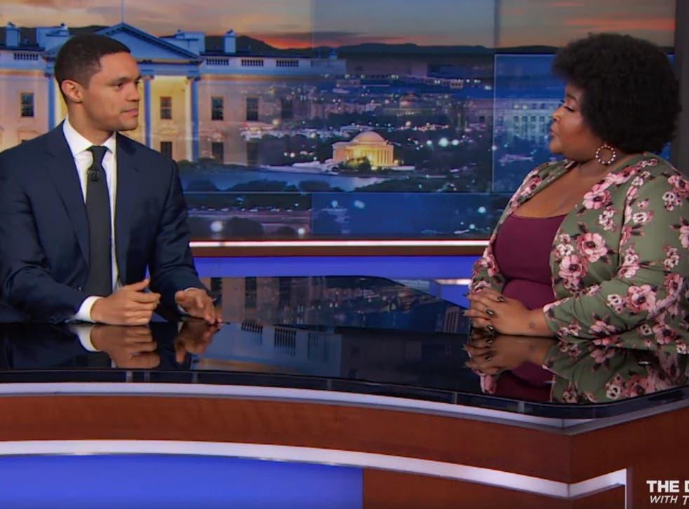 Trevor Noah (left) talks with Dulce Sloan about the Senate race in Alabama.