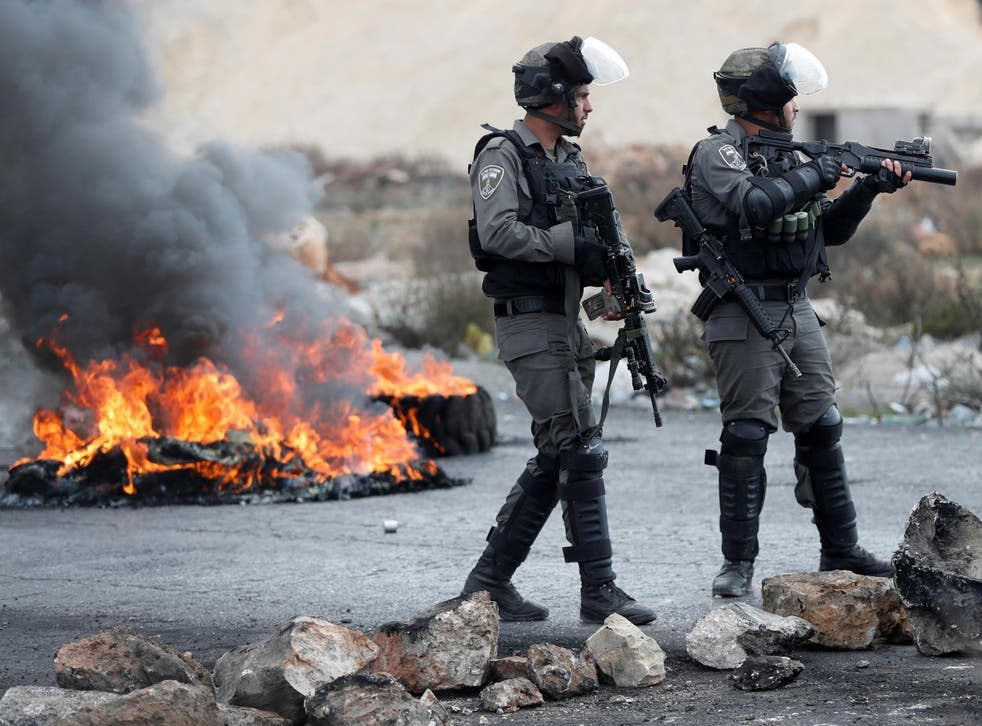 Israeli border police seen during a protest against US President Donald Trump's decision to recognise Jerusalem as the capital of Israel near the West Bank city of Ramallah on 15 December 2017