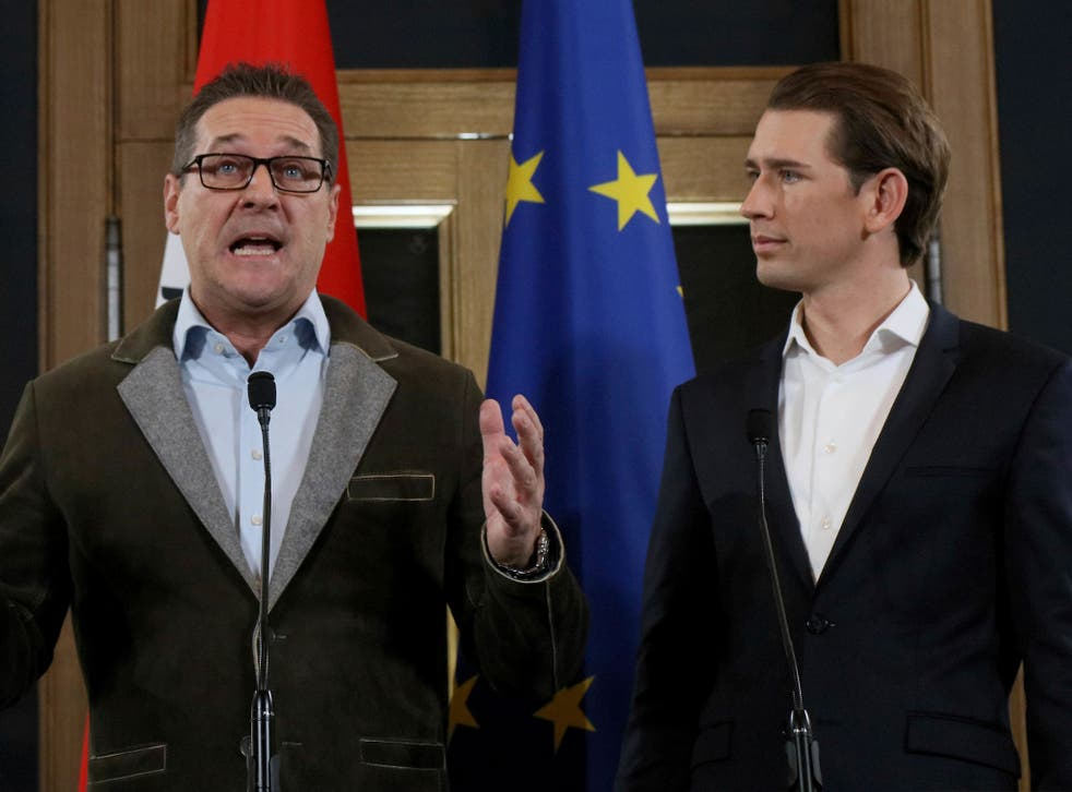 Heinz-Christian Strache (left), chairman of the far-right Freedom Party, and Kurz, foreign minister and leader of the Austrian People's Party, hold a joint news conference after forming the coalition