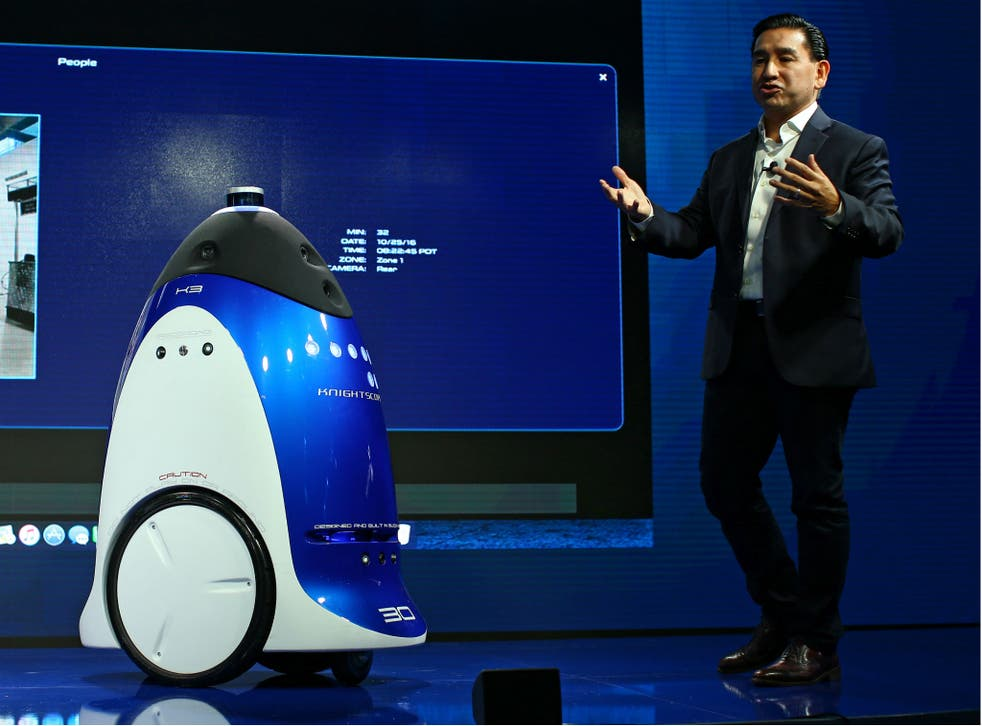 Knightscope Inc. CEO William Santana Li demos a security robot like the one deployed by the SPCA at a conference in Laguna Beach, California
