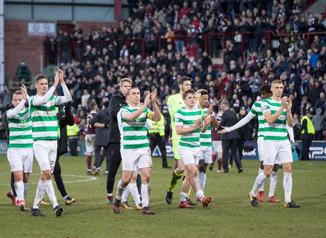 Celtic players applaud the visiting supporters