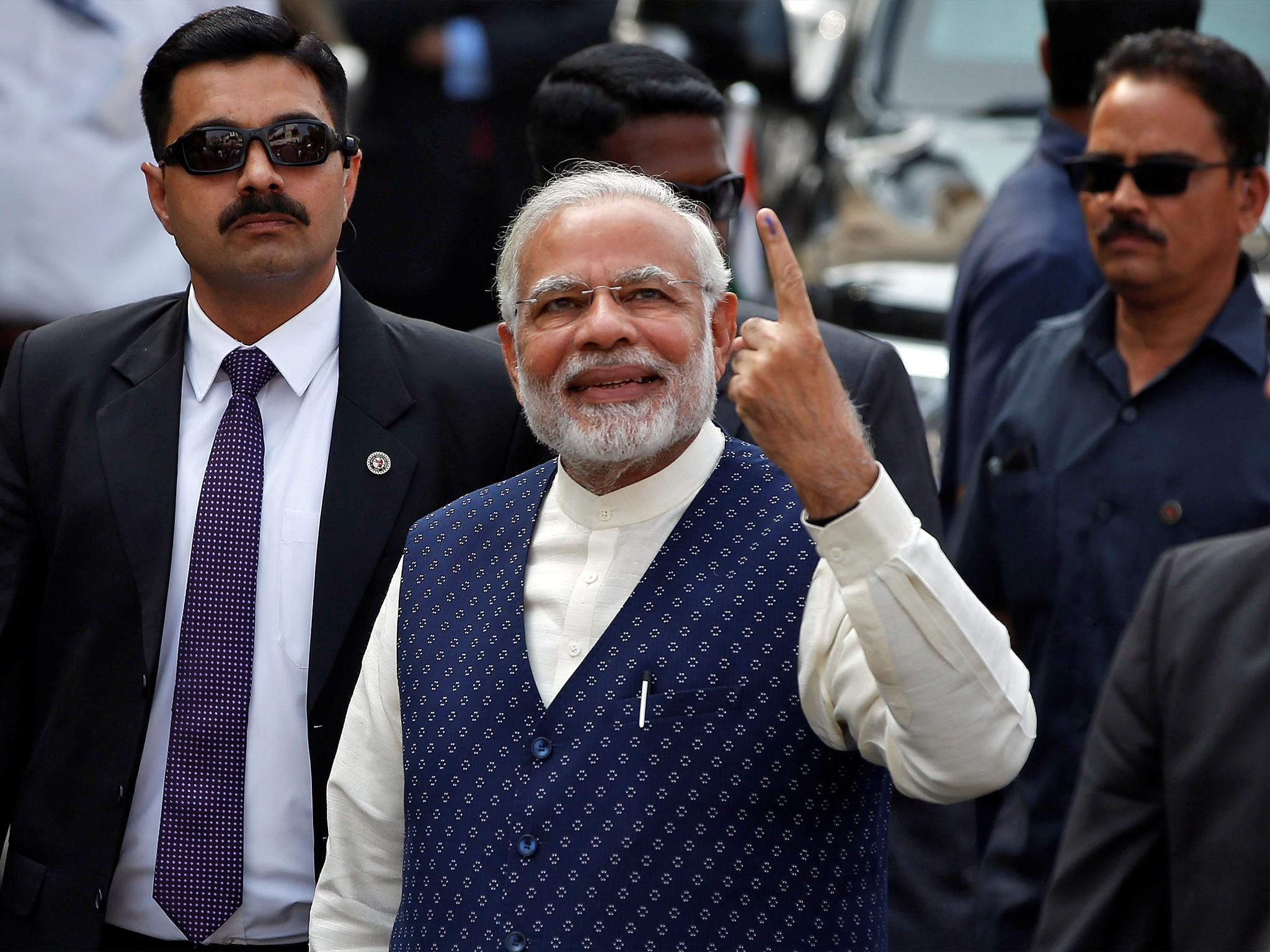 India state elections latest: Narendra Modi's ruling BJP party set for reduced majority in Gujarat