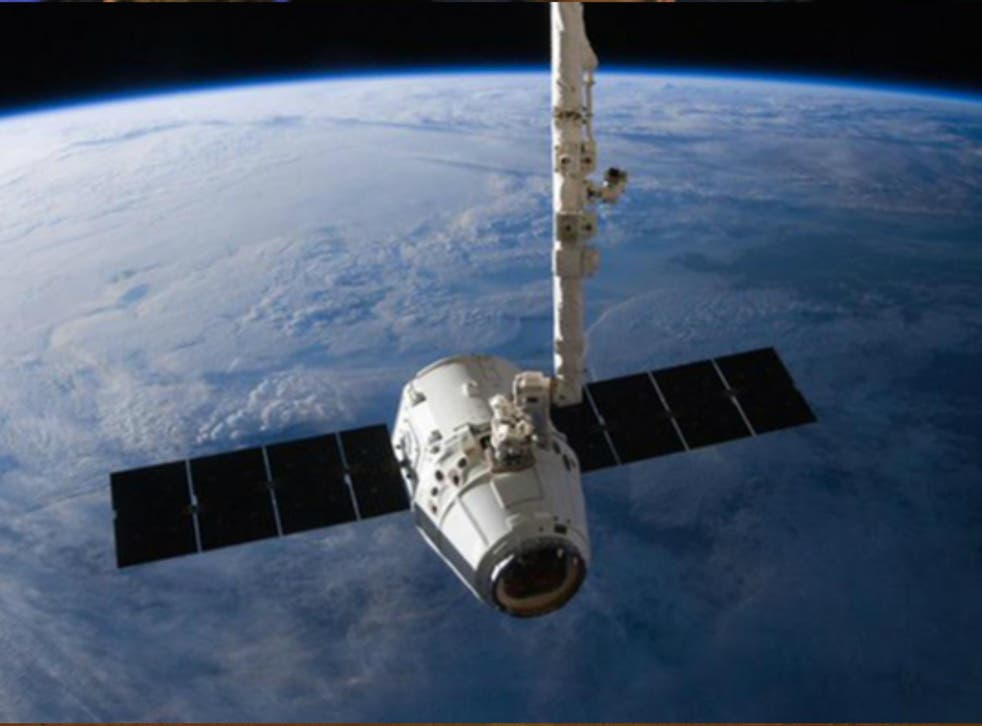 The SpaceX Dragon cargo capsule approaches the International Space Station prior to installation in this NASA picture taken 10 April 2016.