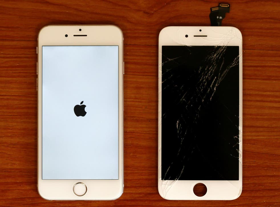 A destroyed iPhone screen and a fixed mobile phone, iPhone 6 by Apple, are pictured in a shop in Fuerstenfeldbruck near Munich, Germany August 16, 2016