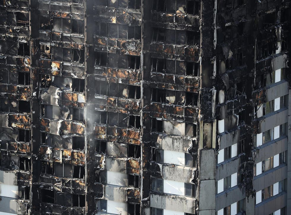 Grenfell Tower continues to smoulder on 15 June 2017