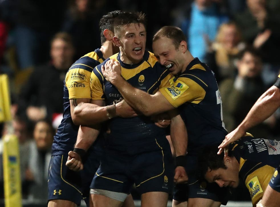 Josh Adams of Worcester Warriors celebrates with team mate Chris Pennell