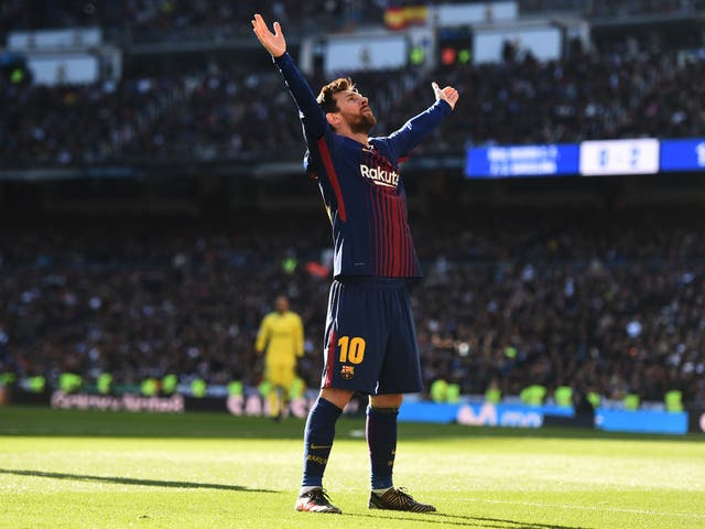 Lionel Messi celebrates after scoring Barcelona's decisive second goal