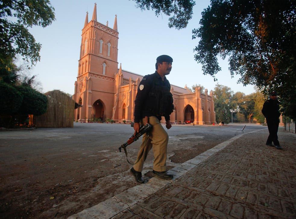 Policeman keeps guard outside a church in Peshawar, Pakistan
