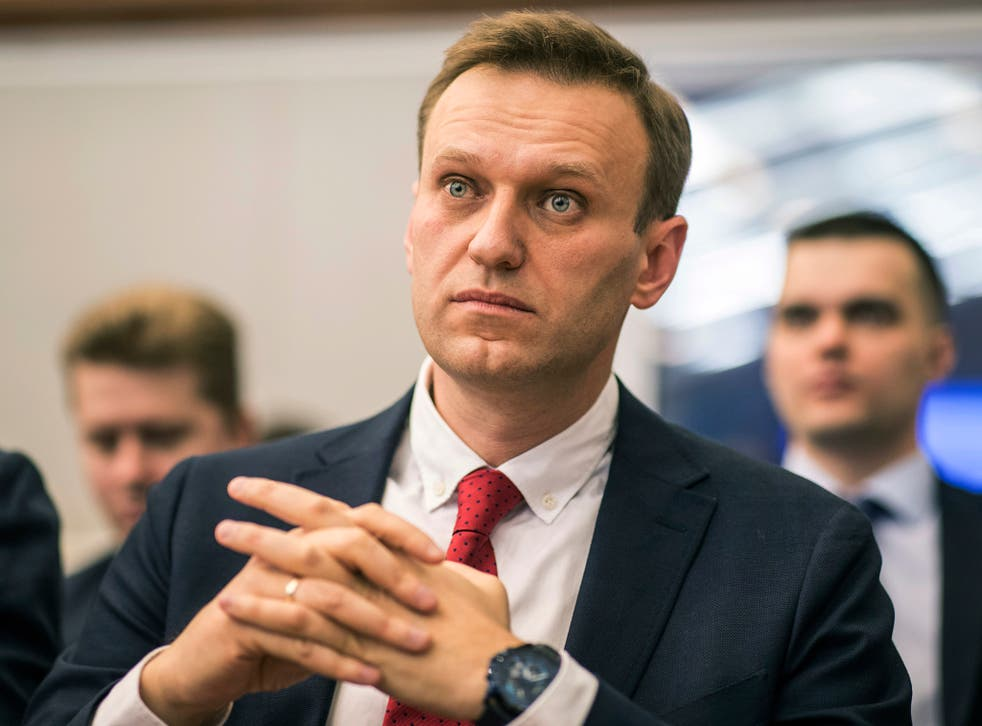 Opposition leader Alexei Navalny sits at Russia's Central Election Commission, which banned him from running for president