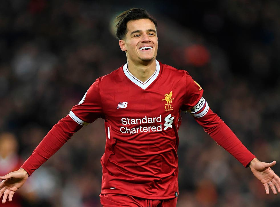 Philippe Coutinho celebrates scoring the opener for Liverpool in the 5-0 thrashing of Swansea