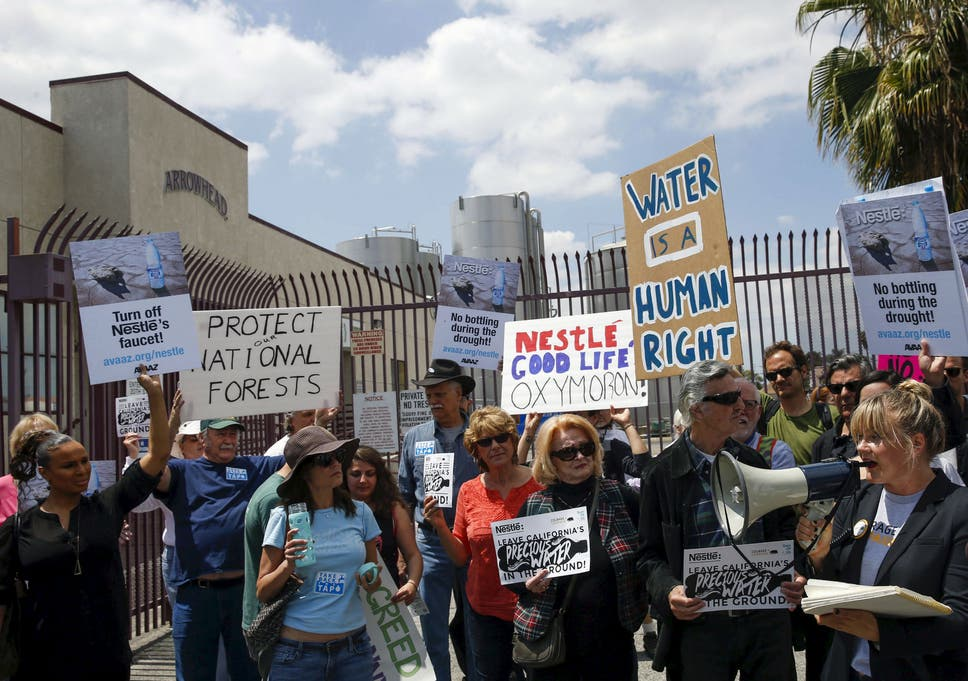 Demonstrators protest against Nestle bottling water during the California drought, outside a Nestle Arrowhead water bottling plant in Los Angeles