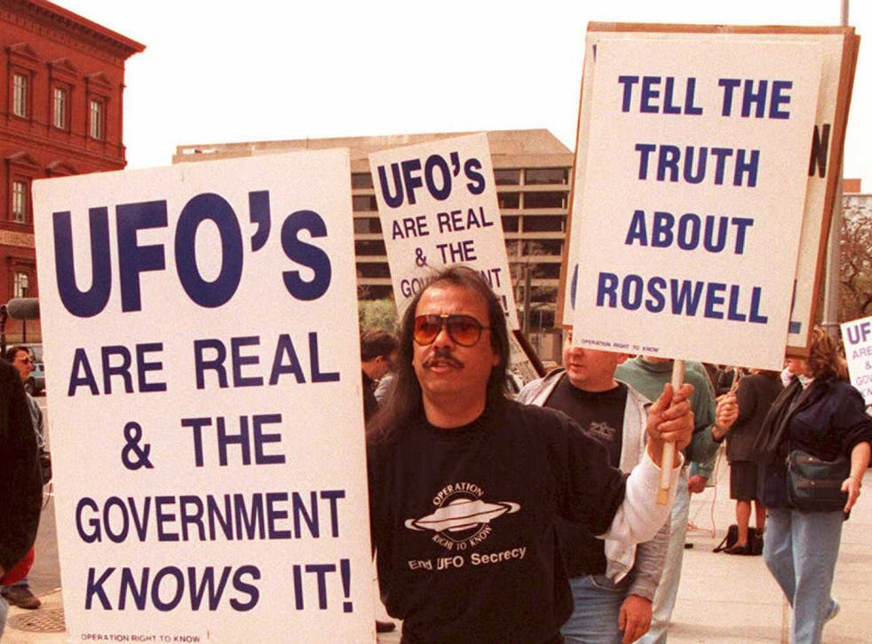 Protestors demand to know about the crash at Roswell in 1947, which they believe was a UFO