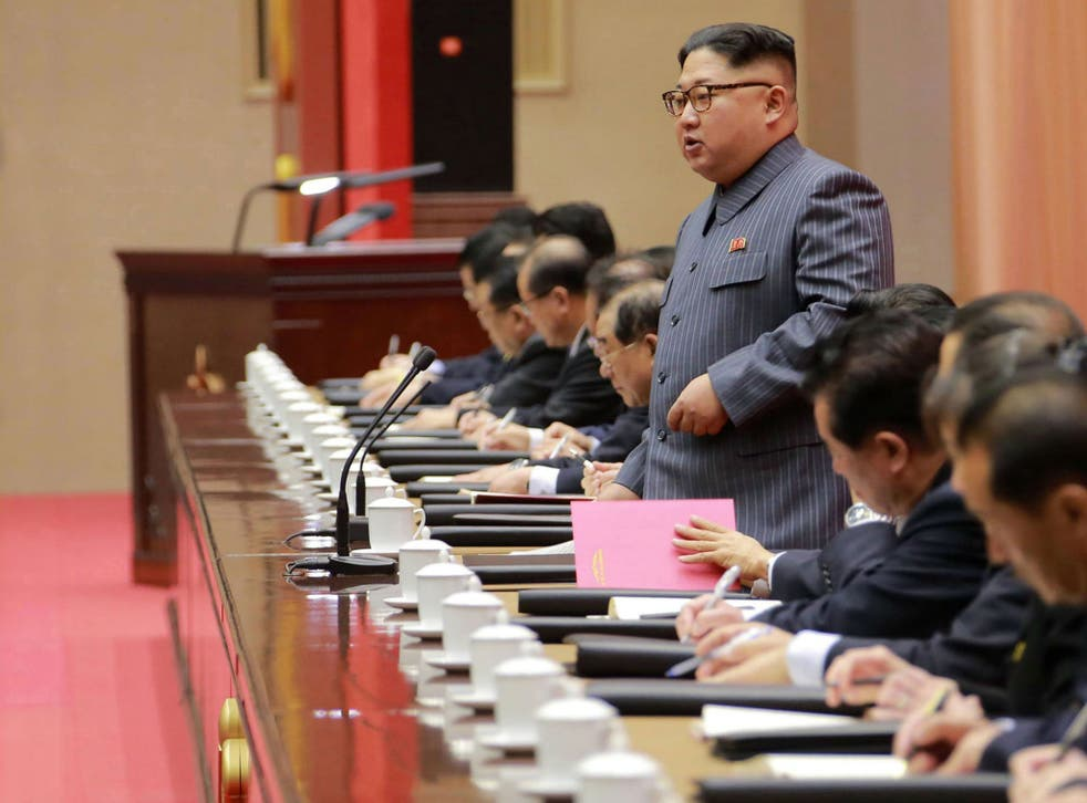 North Korean leader Kim Jong Un addresses a ruling party conference in Pyongyang
