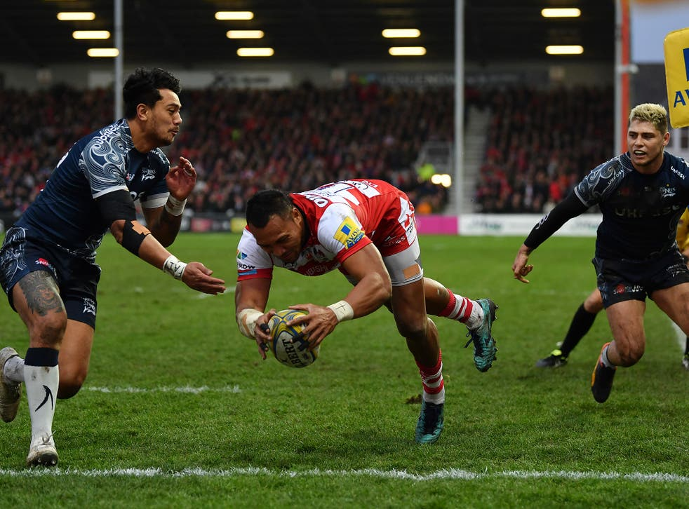 David Halaifonua dives over to score Gloucester's first try