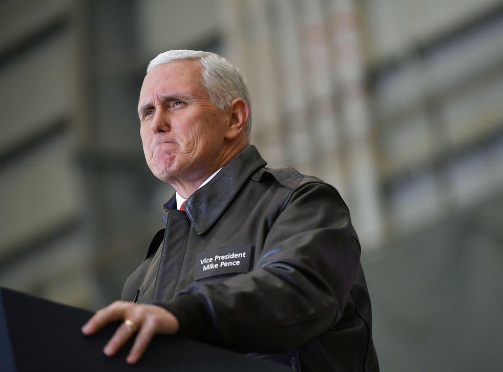 Mike Pence speaks to troops in a hangar at Bagram Air Field in Afghanistan