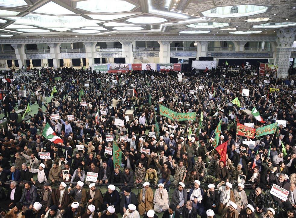 Iranian protesters chant slogans at a rally in Tehran, Iran