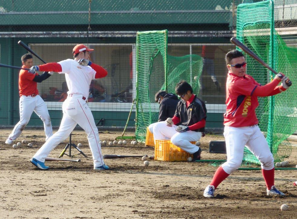 Fukushima Hopes at batting practice during a preseason camp