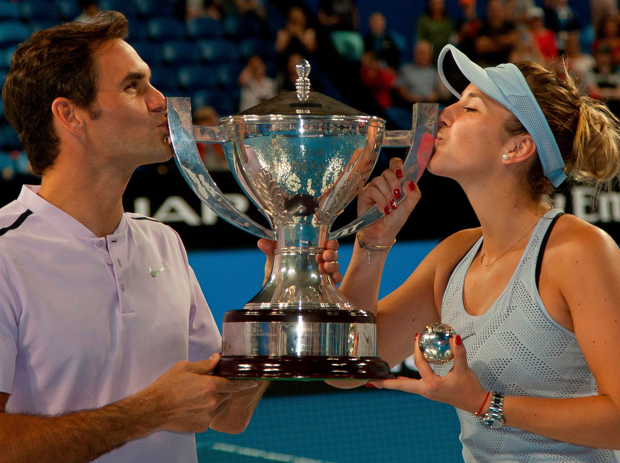Roger Federer and Belinda Bencic clinch Switzerland's third Hopman Cup while Simona Halep triumphs in China