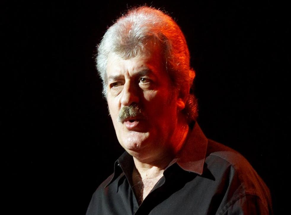 Ray Thomas performs with the Moody Blues