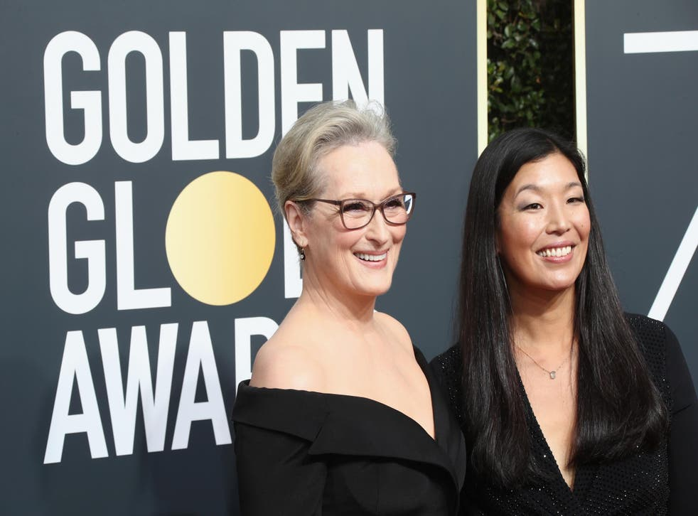 Meryl Streep (L) and Ai-jen Poo attends The 75th Annual Golden Globe Awards at The Beverly Hilton Hotel on January 7, 2018 in Beverly Hills, California. Credit: Frederick M. Brown/Getty Images.