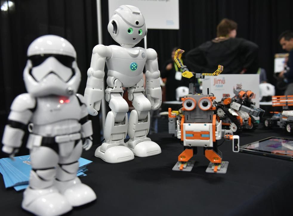 UBTECH robots including the First Order 'Stormtrooper' (L) and the Amazon Alexa voice assistant enabled 'lynx' (C) are seen during the CES Unveiled preview event at the Mandalay Bay Convention Center during CES 2018 in Las Vegas on January 7, 2018