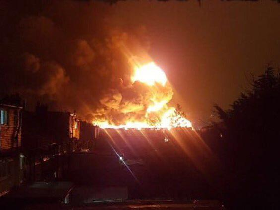 A huge fire has engulfed a factory in London