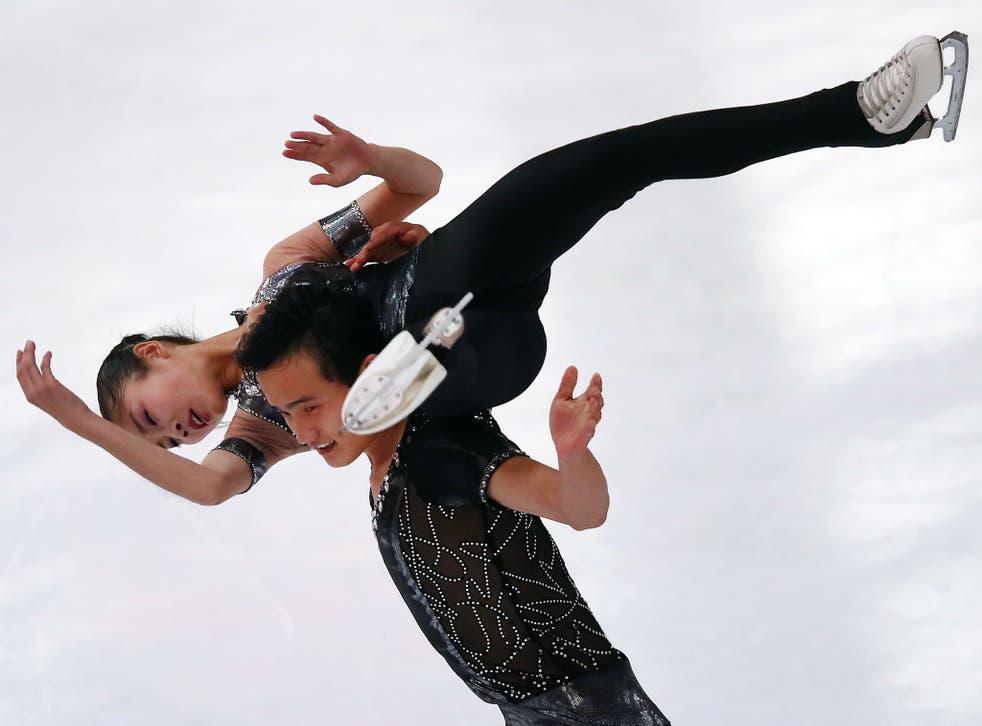 Ryom Tae-Ok and Kim Ju-Sik of North Korea compete in Oberstdorf, Germany