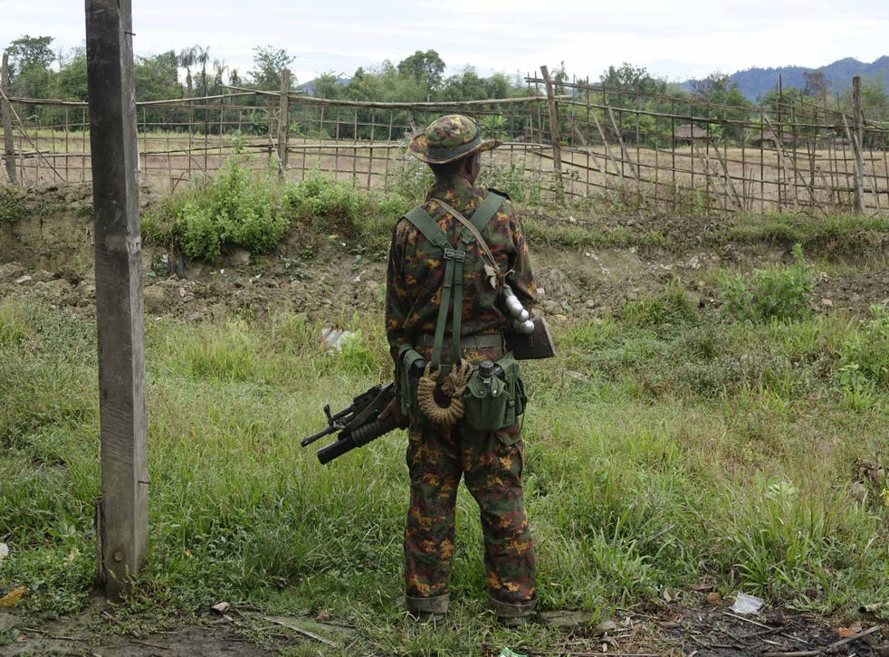 An armed soldier stand guards in Maungdaw township, Rakhine state, western Myanmar